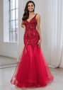 Tulle evening dress with elaborate ornamentation in salsa red